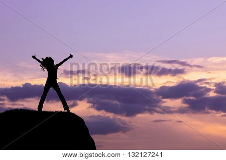 Silhouette Of The Happy Woman On A Hilltop In The Evening