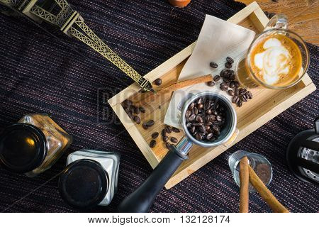 Top View Coffee With Cinnamon, Anise And Cane Sugar And Paris Model On A Wooden Table