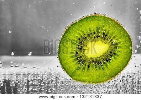 Cut kiwi fruit water . design element