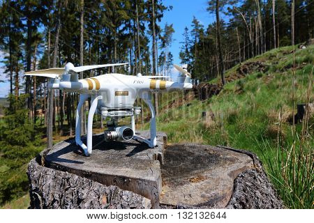 PILSEN CZECH REPUBLIC - APRIL 29, 2016: Drone quadrocopter Dji Phantom 3 Professional with camera. New tool for foresters and firefighters use drones to inspect and fire prevention.