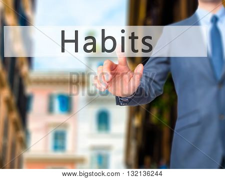 Habits - Businessman Hand Pressing Button On Touch Screen Interface.