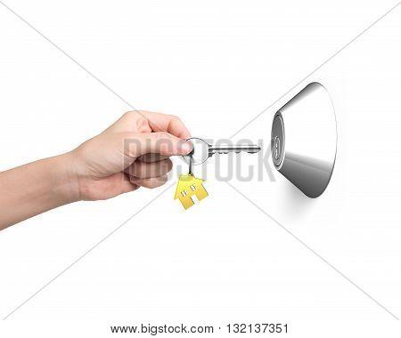 key with house shape key-ring unlocking door isolated in white background