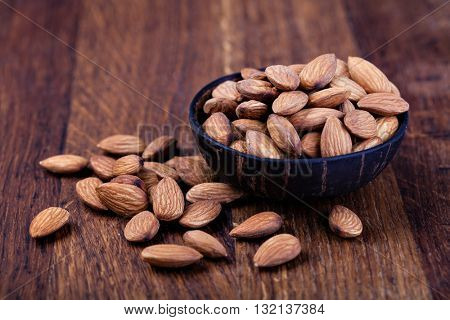 almonds nuts on a wooden table