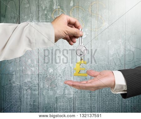 One Hand Giving Key Pound Symbol Keyring To Another Hand