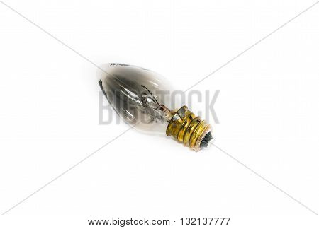 A defective light bulb on white background