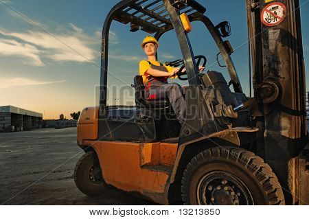 Female worker driving cargo truck