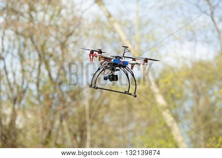 Drone flying in forest