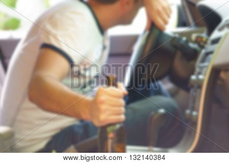 Drunk man sleeping in the car