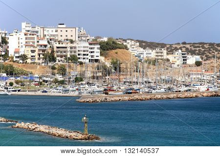 Boats in the Harbor, Agios Nikolaos, Crete, Greece / Boats and Yachts Anchored in the Harbour