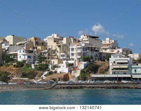Seafront at Agios Nikolaos, Crete, Greece / Buildings and Beach on Eastern Part of Agios Nikolaos