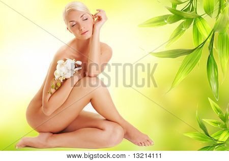 Beautiful young woman with white orchid flower