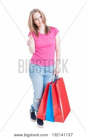 Attractive Shopaholic Girl Showing Thumb Up Or Like Gesture
