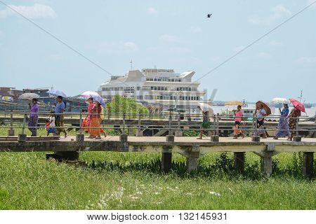 Yangon Myanmar - April 25 2016 : People walking on bridge at Botahtaung Jetty port