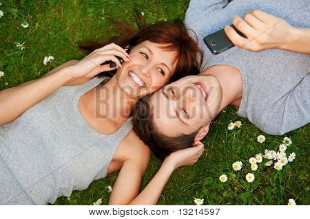 Young couple with mobile phones outdoor
