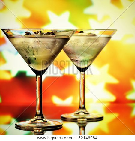 Cocktail glasses and blurred stars in the background