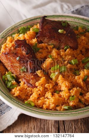Asian Bulgur Pilaf With Meat Close Up On A Plate. Vertical