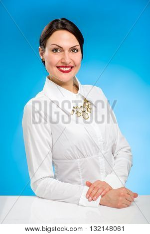Portrait of beautiful female model on blue background