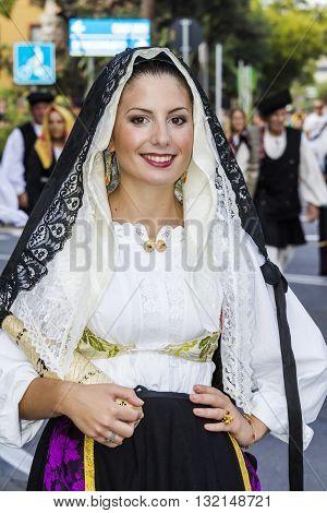 SELARGIUS, ITALY - 2015 September, 13: Former marriage Selargino - Sardinia - portrait of a beautiful smiling woman in Sardinian costumes