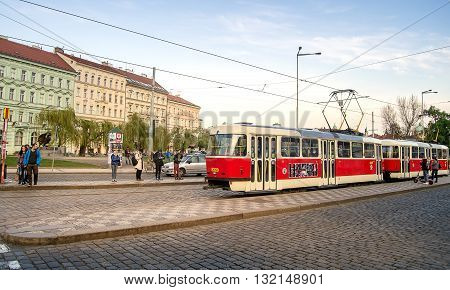 Prague Czech republic - April 22 2015 - Red tram stopping at a stop in the center of Prague.