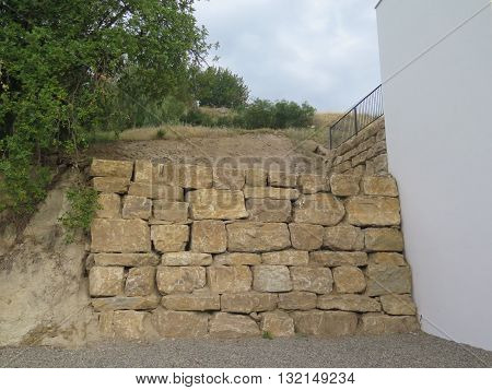 Retaining wall from granite blocks in residential area in Alora Andalusia