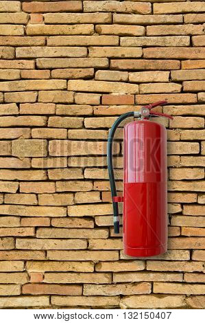Fire extinguisher on brick wall, Fire protection.