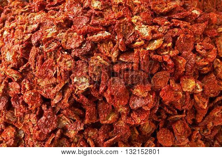 Sun dried tomatoes from top view. Background.