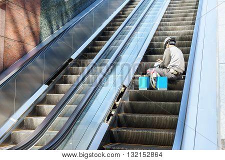 Technician Maintenance of escalators in the building