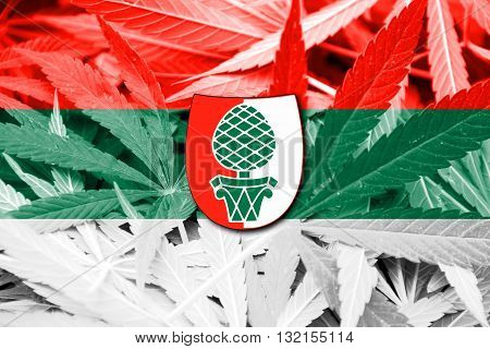 Flag of Augsburg on cannabis background. Drug policy. Legalization of marijuana