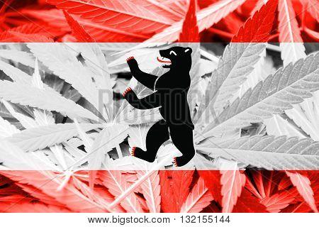 Flag of Berlin on cannabis background. Drug policy. Legalization of marijuana
