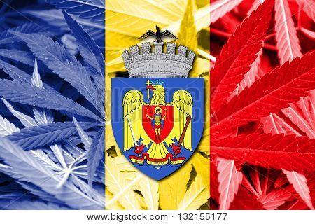 Flag of Bucharest on cannabis background. Drug policy. Legalization of marijuana