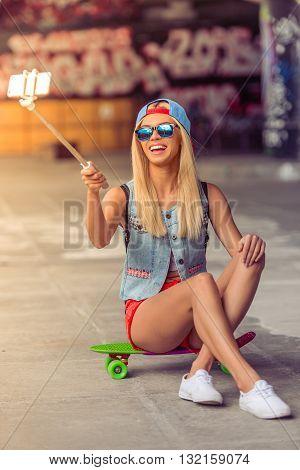 Skateboarding Girl With Gadget