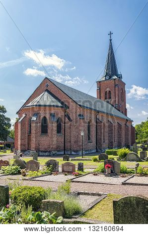 A red brick church in the Swedish town of Rya.