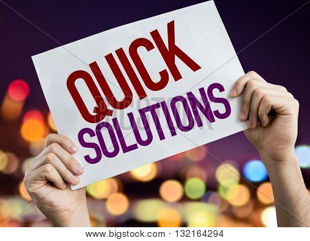 Quick Solutions placard with bokeh background