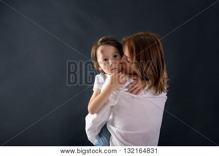 Cute Little Boy With Big Bump On His Forehead From Falling, Hugging His Mom