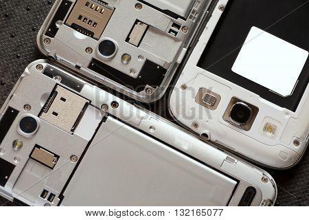 Disassembled cell phones closeup shot top view selective focus