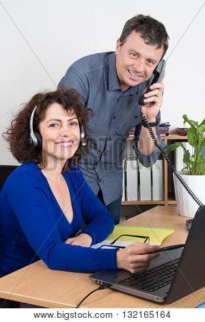 Manager On Phone Explaining Something To His Employee