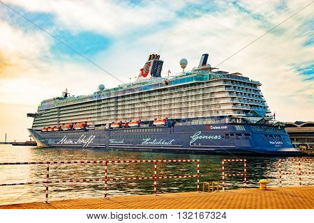 GDYNIA, POLAND - MAY 31, 2016: The magnificent luxury cruise ship the Mein Schiff 4 is docked at wharf in Port of Gdynia. Cruise ship owned by TUI Cruises. Built by Turku Shipyard in Turku, Finland.