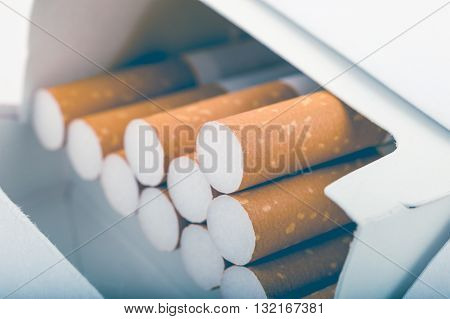 Side View Of A Pack Of Cigarettes With Faded Filter