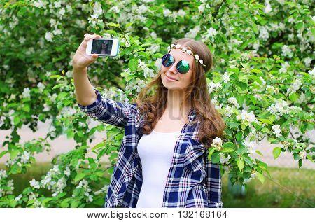 Beautiful Hippie Woman Makes Self Portrait On Smartphone In Spri