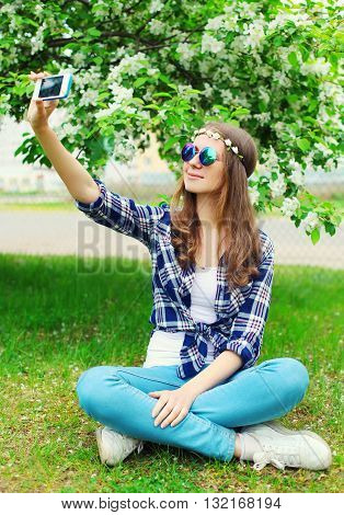 Beautiful Hippie Woman Makes Self-portrait On Smartphone Sitting