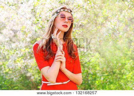 Fashion Beautiful Hippie Woman In A Flowering Garden