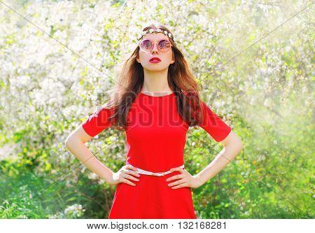 Fashion Beautiful Hippie Woman In Spring Flowering Garden