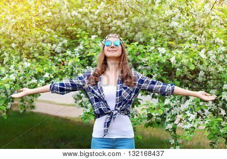 Happy Hippie Woman Enjoying Smell In Flowering Spring Garden