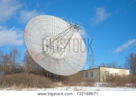 The antenna of the radio telescope and building astrophysical laboratory, sunny february afternoon. Pulkovo astronomical Observatory, St. Petersburg, Russia