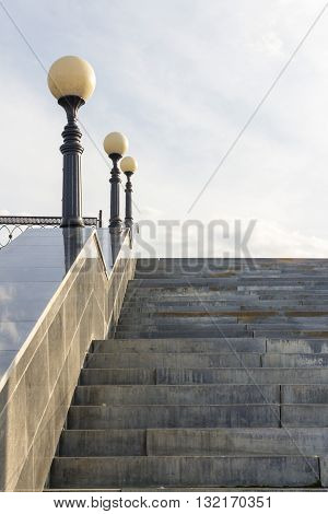 stairs and lamp posts,stairs with lights,marble slabs on the stairs