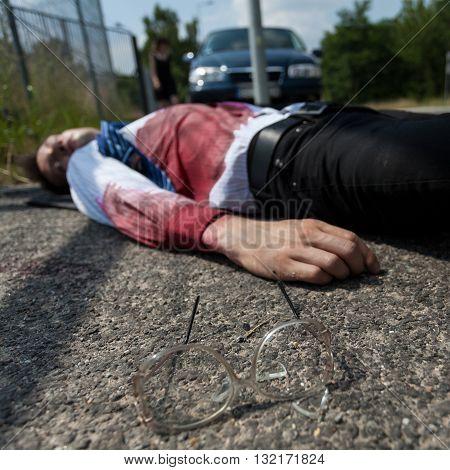 Bleeding Man Lying On The Street