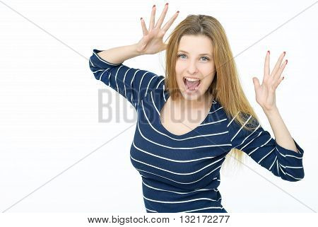 Portrait of young woman fooling around and scaring someone