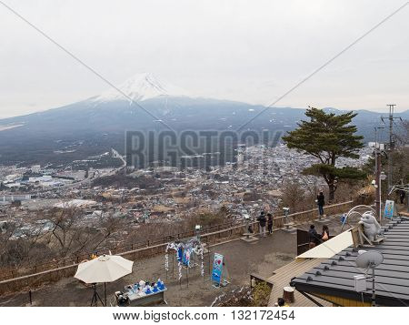 Tokyo - January 29 2015: The observation deck for viewing the volcano Fuji and tourists are looking at the mountain and is visible snowy peak of the volcano winter January 29 2015 Tokyo Japan