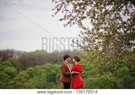 Couple Hugging In Love Background Fantastic Nature And Landscape. Stylish Man At Velvet Jacket And G