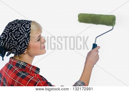 Young woman with roller brush. Isolated on white background